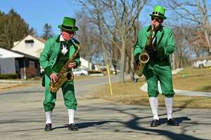 Leprechauns Josh Greenberg, left, and Luke McNamee parade up Norwood St. playing Irish tunes on their saxophones to celebrate the upcoming holiday of St. Patrick's Day on Saturday, March 13, 2021 in Guilderland, N.Y. (Lori Van Buren/Times Union)
