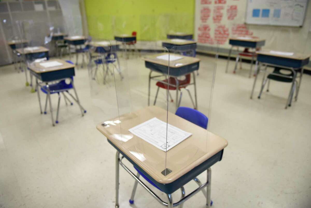A classroom set up with COVID-19 precautions at Northeast Elementary School in Stamford, Conn. Monday, March 8, 2021.