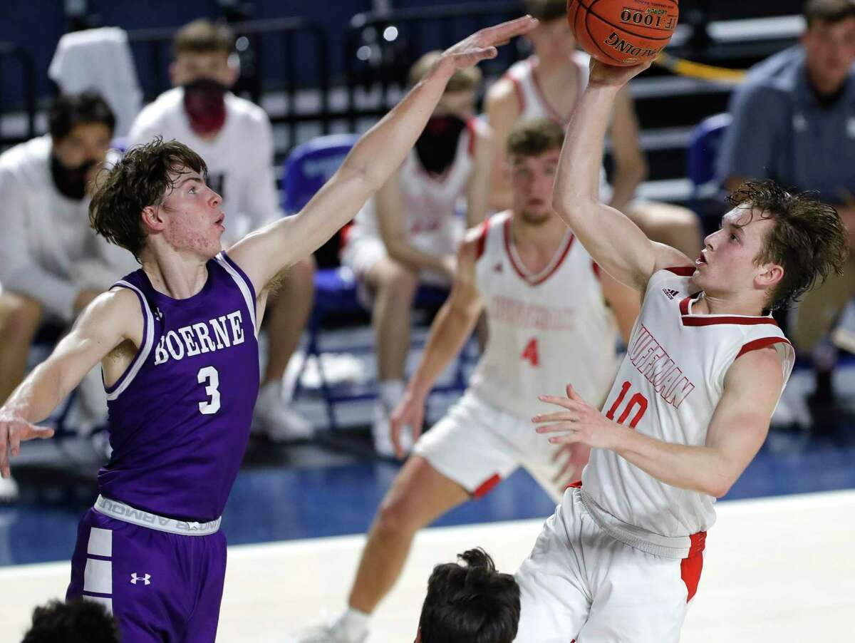 Huffman point guard Jacob Harvey (10) makes a shot past Boerne shooing guard Ben Phillip (3) during the third quarter of a Region III-4A state semifinal game at Delmar Fieldhouse, Tuesday, March 9, 2021, in Houston. Huffman defeated Boerne 55-49.
