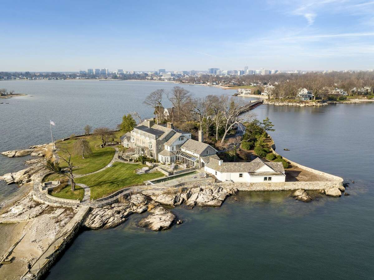 Caritas Island, also known as Greenaway Island, is part of the private waterfront compound of Wallacks Point in Stamford. The property was recently listed for $14.5M. Across the island's four acres, one will find everything from private beaches and gardens to a 55-foot-lap pool and tennis court. The inside of the English-style manor serves as a master class on how to properly marry a New England colonial with 20th century grandeur straight out of