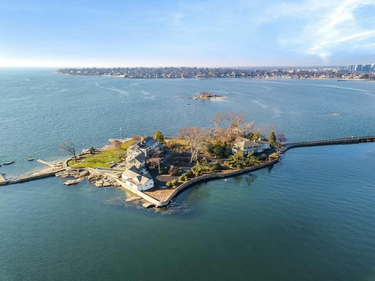 Caritas Island, also known as Greenaway Island, is part of the private waterfront compound of Wallacks Point in Stamford. The property was recently listed for $14.5M. The island is connected to the mainland by a gated, private bridge and is only a quick drive from Shippan. Don't want to drive your car onto the island? No worries. The island has a 200-foot-deep water dock so you can dock your boat. Caritas Island also boasts its own helipad.
