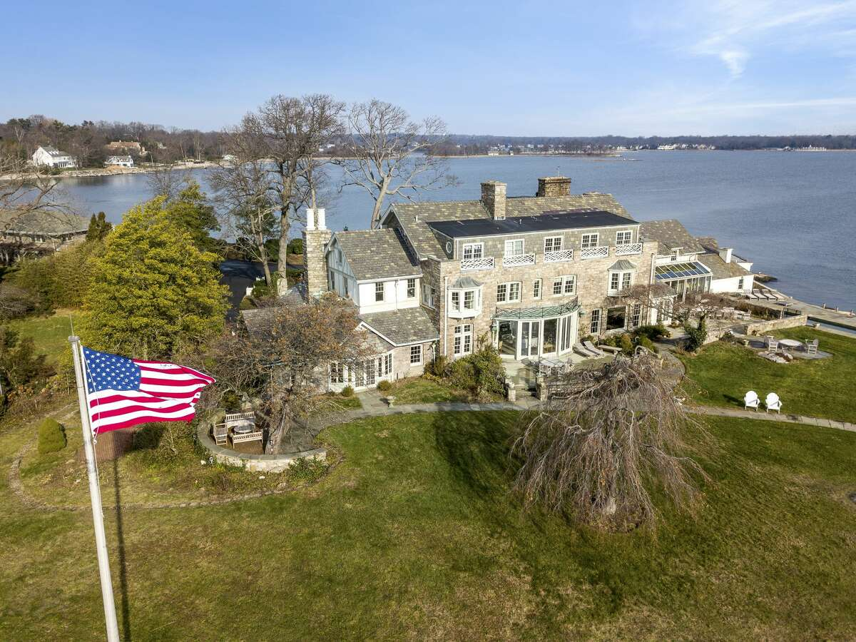 Caritas Island, also known as Greenaway Island, is part of the private waterfront compound of Wallacks Point in Stamford. The property was recently listed for $14.5M. The central home contains 12 bedrooms, eight fireplaces, a number of offices and formal rooms and an expansive terrace. Covering 17,000 square feet of the island, the home also has its own four-car garage, workshop and library. Outside of the central manor, Caritas Island is also home to a Dutch Colonial house with three bedrooms and two bathrooms, and a detached six-car carriage house with two apartments - one with three bedrooms and one bathroom and the other with one bedroom and one bathroom.