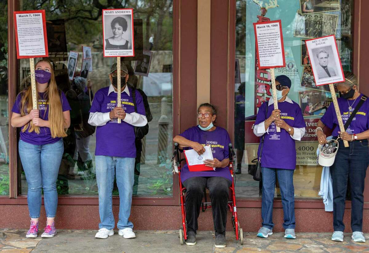 Lifelong San Antonian, East Side resident and a member of the Coalition for the Woolworth Building Nettie Hinton, seated, speaks Tuesday in front of the Woolworth Building at the corner of Alamo and Houston streets about the peaceful integration of the downtown institution on March 16, 1960.