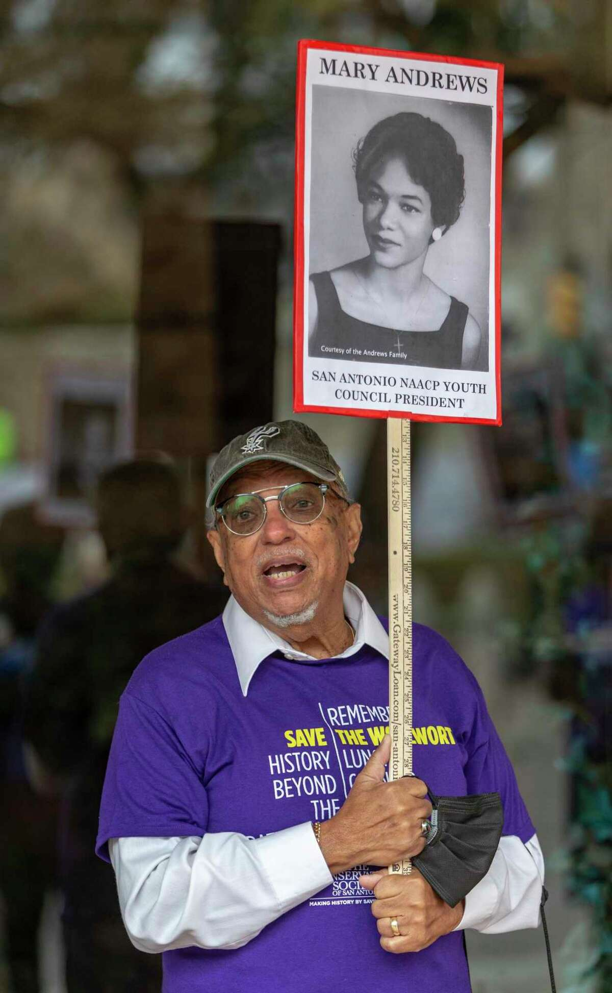 Chuck Andrews holds a picture of sister Mary Andrews outside the Woolworth Building as he talks about the peaceful integration of the Woolworth lunch counter, which his sister was a part of in 1960.