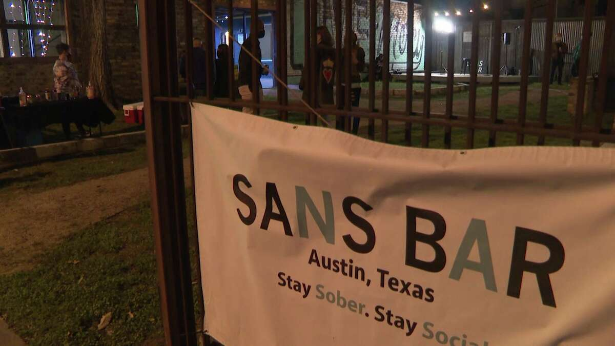 In this March 5, 2021 photo, customers enter Sans Bar in Austin, Texas. According to IWSR Drinks Market Analysis, global consumption of zero-proof beer, wine and spirits is growing two to three times faster than overall alcohol consumption.