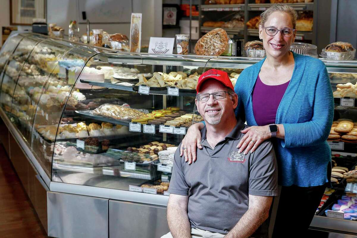 Three Brothers Bakery owners Bobby and Janice Jucker stand for a portrait at their South Braeswood Boulevard location Friday Aug. 17, 2018 in Houston. The location has flooded multiple times over the last decade and was most recently inundated by four and a half feet of water during Hurricane Harvey.