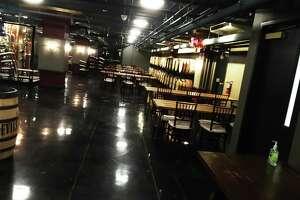 The basement speakeasy space at Devils River Distillery.