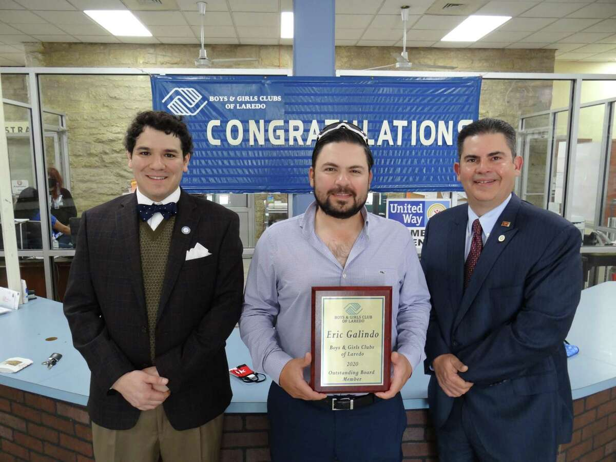 Laredo Boys and Girls Clubs board of directors newly-elected president Andrew Carranco, left, and outgoing president Willie Martinez flank, Eric Galindo, named board member of the year at the annual B&G Clubs annual meeting.
