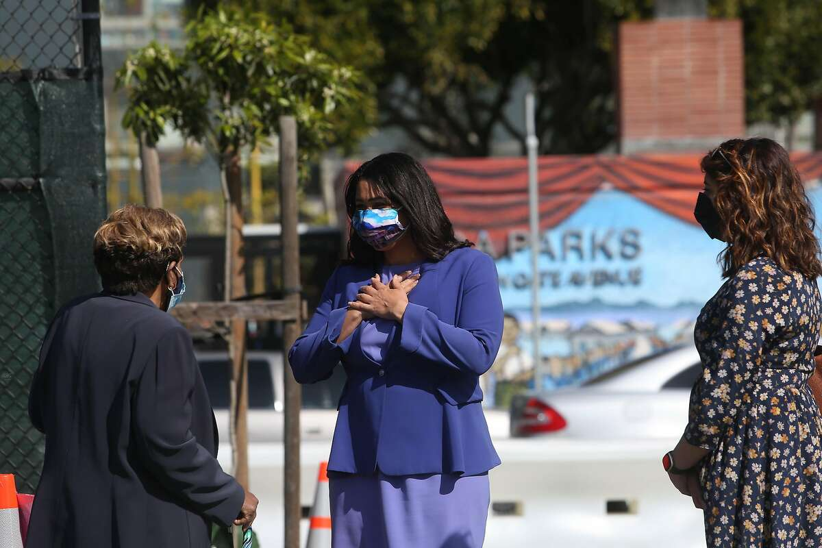 Mayor London Breed (right) greets Gracie Palmer (left) of San Francisco as Breed arrives at Maxine Hall Health Center to get the Johnson and Johnson COVID-19 vaccine on Tuesday. Palmer had gotten her vaccination earlier and her daughter was a childhood friend of Mayor Breed.