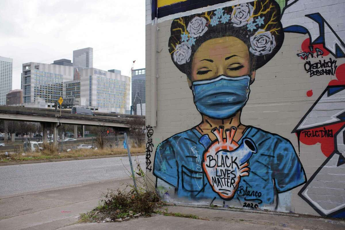 A mural overlooks part of the downtown skyline in Houston, Texas on March 10, 2021.