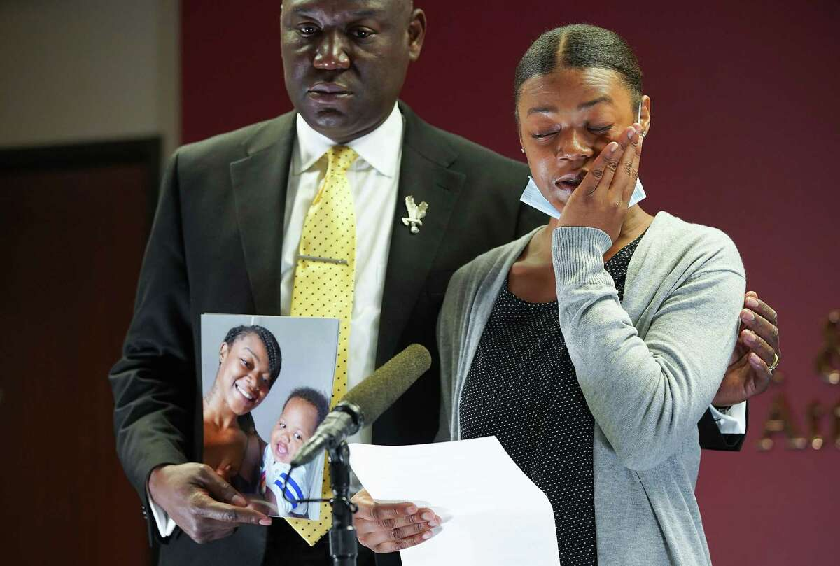 Daisha Smalls wipes away tears as she talks about what happened on March 3, when her son, Legend, was shot by the Houston Police.