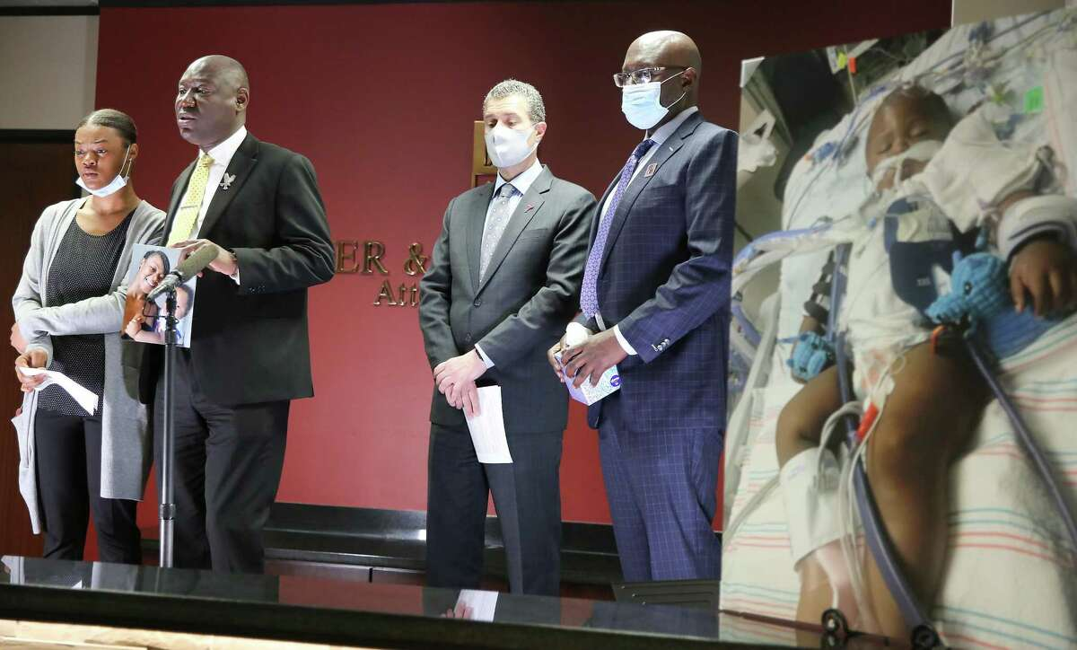 Attorney Ben Crump address the media with Daisha Smalls, from left, Antonio Romanucci and Darren Miller in Houston on Tuesday, March 16, 2021. Daisha's one-year-old son, Legend, was hit in the head by a bullet shot by Houston Police on March 3.
