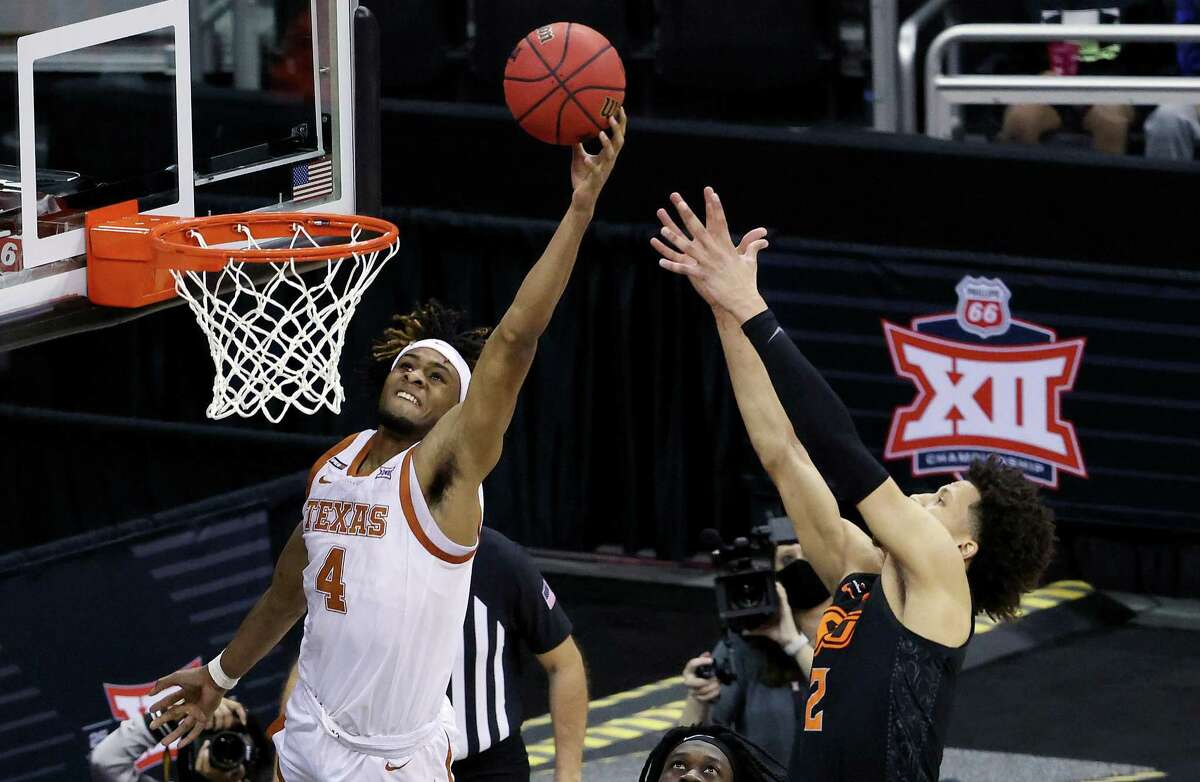 KANSAS CITY, MISSOURI - MARCH 13: Greg Brown #4 of the Texas Longhorns beats Cade Cunningham #2 of the Oklahoma State Cowboys for a rebound during the Big 12 Basketball Tournament championship game at the T-Mobile Center on March 13, 2021 in Kansas City, Missouri. (Photo by Jamie Squire/Getty Images)