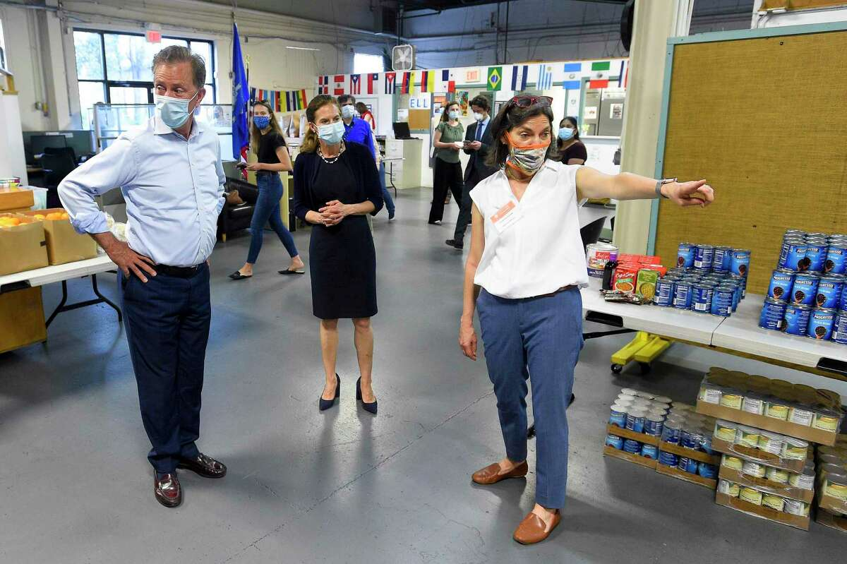 At right, Executive Director Catalina Samper-Horak shows Connecticut Governor Ned Lamont and Lt. Governor Susan Bysiewicz the collected donations gathered from the community as they visited Building One Community in Stamford, Connecticut on May 29, 2020. On March 15, 2021, Samper-Horak was announced as the interim CEO of the nonprofit 4-CT.