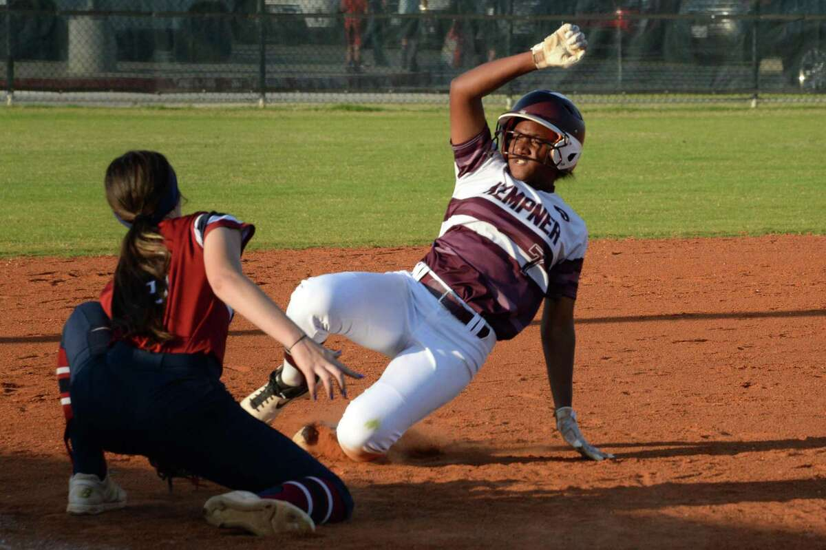 Lauren Hatch (7) of Kempner slides into third base during the first inning of a Class 6A Region III bi-district playoff softball game between the Tompkins Falcons and the Kempner Cougars on Friday, April 26, 2019 at Paetow High School, Katy, TX.