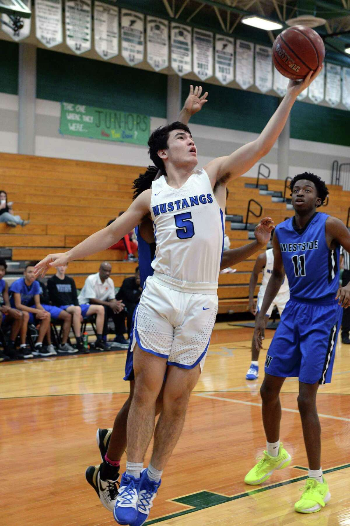 Jake Arnold (5) of Taylor attempts a lay-up during pool play of the Katy Classic Basketball Tournament between the Taylor Mustangs and the Westside Wolves on Thursday, December 5, 2019 at Mayde Creek HS, Houston, TX.