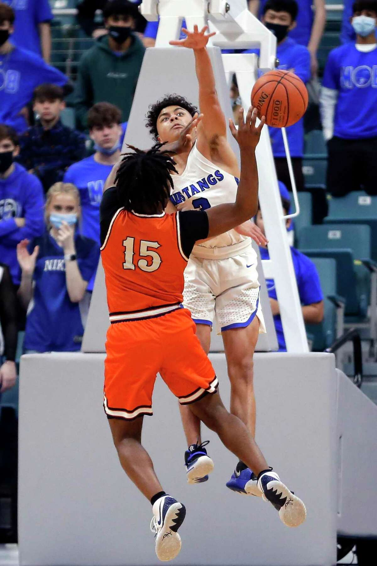 Bush's Kameron Harris (15) puts up a shot as Katy Taylor's Luke St. Julien, left, defends during a playoff game last moth. St. Julien was named the district's defensive player of the year.