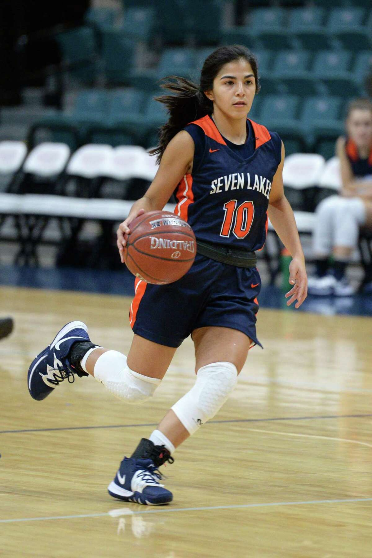 Ximena Diez (10) of Seven Lakes dribbles past mid-court during the first half of the third place game in the Katy Classic Basketball Tournament between the Seven Lakes Spartans and the Mansfield Tigers on Saturday, December 7, 2019 at the Leonard Merrell Center in Katy, TX.