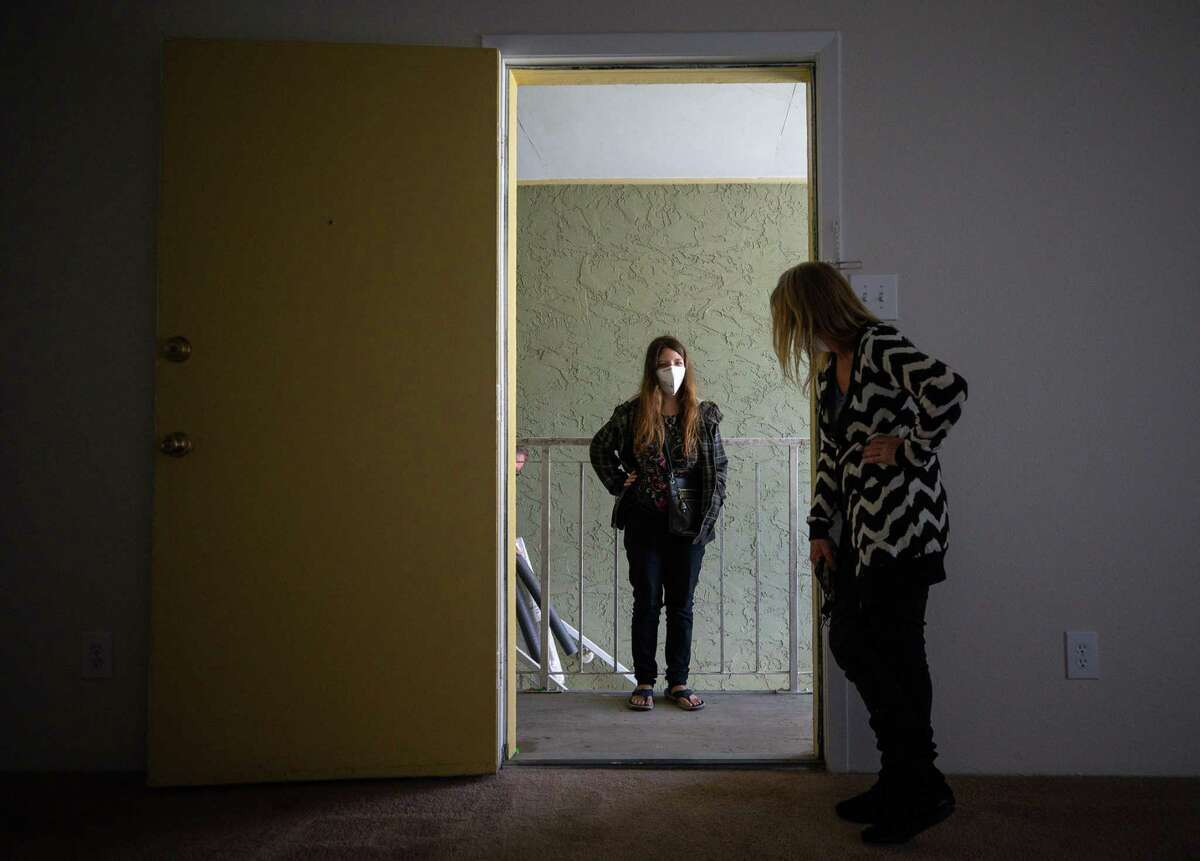 Aaliyah Lewis, center, and her mother Tina Harris, right, check out their new apartment at Carelton Courtyard Apartments on Tuesday, March 16, 2021, in Galveston, Texas. The two had been living at the Sandpiper Cove Apartments prior to this.