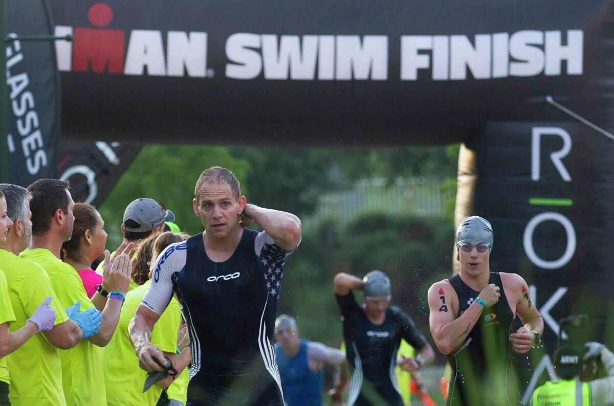 The Memorial Hermann Ironman Texas triathlon in The Woodlands has been postponed because of the COVID-19 threat level in Harris County, event organizers announced Tuesday.