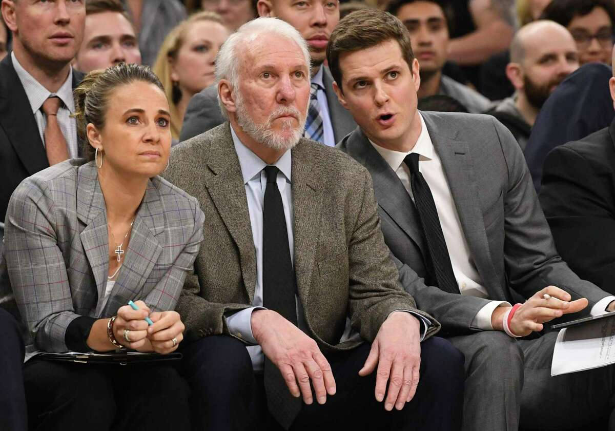 A media question about trailblazing assistant coach Becky Hammon, second from left, prompted Gregg Popovich to express his hope that more women will be in positions of power in the future.
