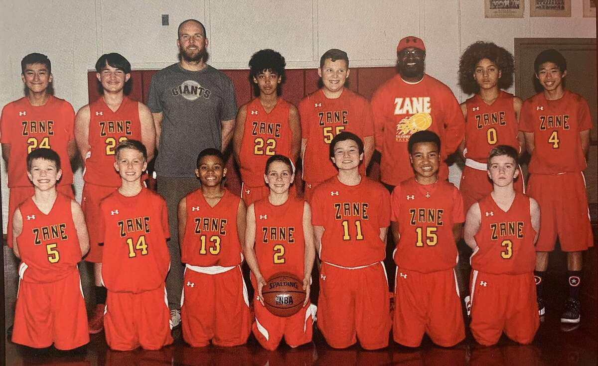 Jeff Bird (pictured in Giants shirt) poses with the boys basketball team he coaches at Zane Middle School in Eureka, Calif.