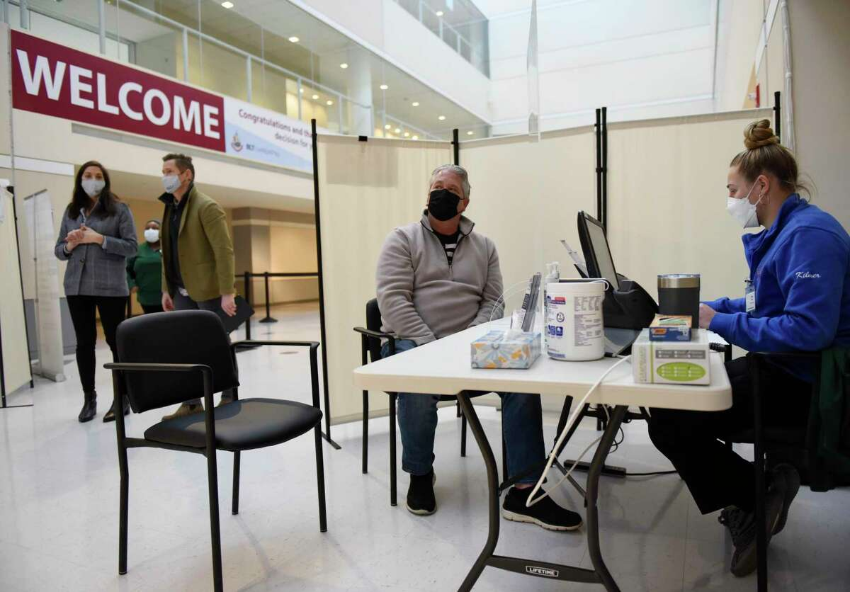"""Norwalk's Kevin Angers checks in during the grand opening of the COVID-19 vaccine """"super site"""" at Silicon Harbor in Stamford on March 15, 2021. The site has since been shuttered."""