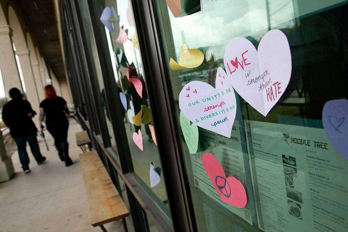 Hearts with supportive messages are taped to the front doors and windows at Noodle Tree on Tuesday, March 16, 2021.