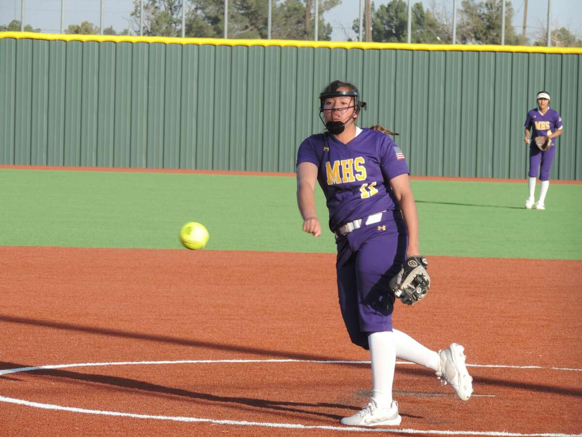 Midland High junior Alex Aguilar delivers a pitch to a San Angelo Central batter during Tuesday's District softball game at Martin Field.