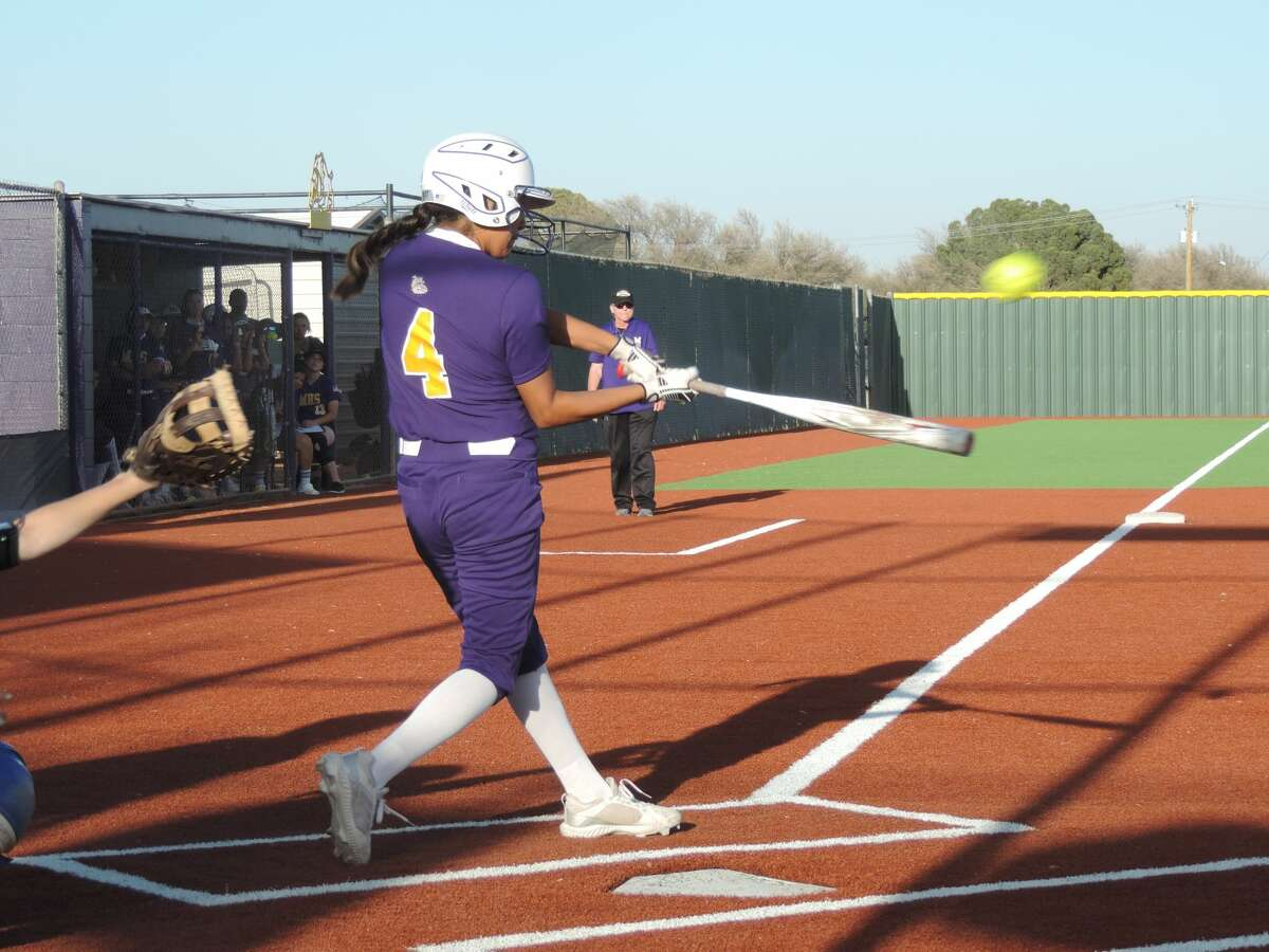 Midland High center fielder Nalaney Paul connects with a San Angelo Central pitch during Tuesday's District 2-6A softball game at Martin Field.