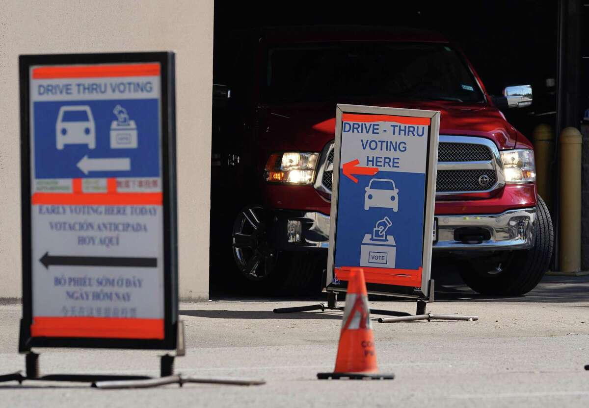 A vehicle leaves a drive-thru voting location at Toyota Center on Election Day Tuesday, Nov. 3, 2020 in Houston.