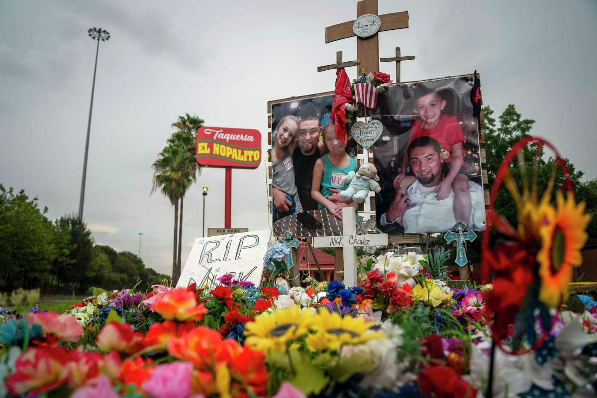 A tribute to Nicolas Chavez, 27, who was shot and killed April 21 by several police officers during a confrontation in Denver Harbor, sits at the site of the shooting along Interstate 10, Thursday, Sept. 10, 2020 in Houston. Police released video of the shooting on Thursday afternoon. (Mark Mulligan/Houston Chronicle via AP)