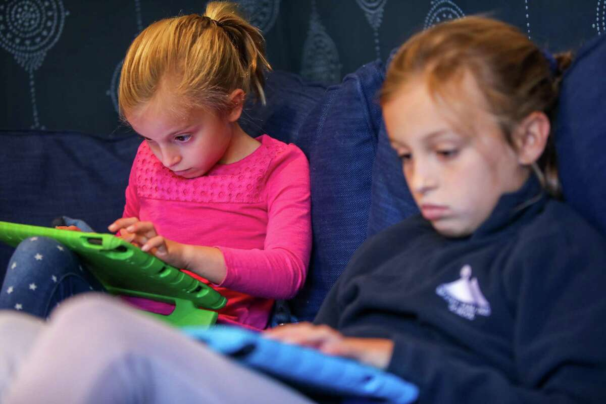 Sisters Lizzie, 8, and Cate Blanchard, 11, of Mill Valley, Calif., engage in the video game/virtual reality platform Roblox, which went public this month through a direct listing instead of an IPO.