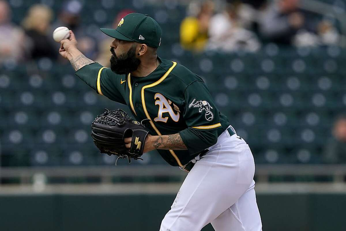 Oakland Athletics' pitcher Sergio Romo throws against the San Diego Padres on March 12.