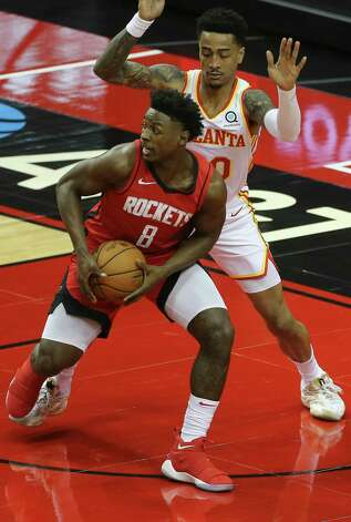Atlanta Hawks guard Rajon Rondo (7) drives toward the basket while Houston Rockets forward Anthony Lamb (33) is trying to stop him durign the second quarter of the NBA game Tuesday, March 16, 2021, at Toyota Center in Houston. Photo: Yi-Chin Lee, Staff Photographer / © 2021 Houston Chronicle