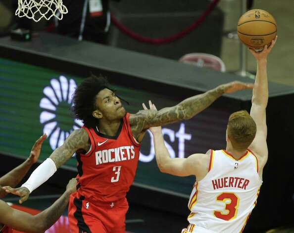 Houston Rockets forward Kenyon Martin Jr. (6) puts the ball into the basket while Atlanta Hawks forward John Collins (20) watches on durign the second quarter of the NBA game Tuesday, March 16, 2021, at Toyota Center in Houston. Photo: Yi-Chin Lee, Staff Photographer / © 2021 Houston Chronicle