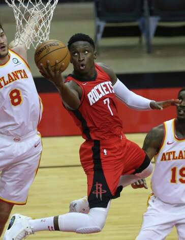 Atlanta Hawks forward John Collins (20) battles for the ball against Houston Rockets players Kenyon Martin Jr. (6) and Victor Oladipo (7) durign the second quarter of the NBA game Tuesday, March 16, 2021, at Toyota Center in Houston. Photo: Yi-Chin Lee, Staff Photographer / © 2021 Houston Chronicle