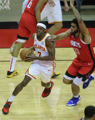 Houston Rockets forward Jae'Sean Tate (8) dunks the ball durign the first quarter of the NBA game against the Atlanta Hawks Tuesday, March 16, 2021, at Toyota Center in Houston. Photo: Yi-Chin Lee, Staff Photographer / © 2021 Houston Chronicle