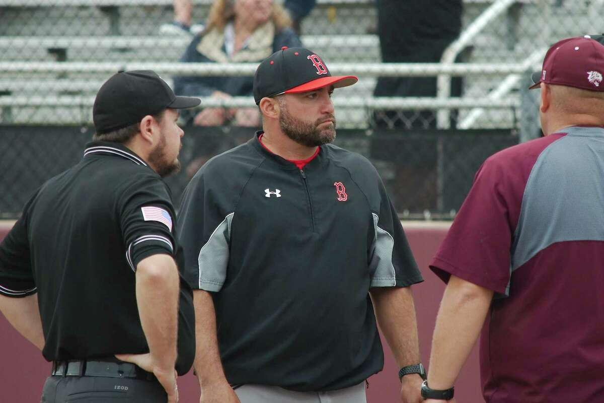 Clear Brook baseball coach Gene Flores watched his team roll to a 9-1 victory over Clear Lake Tuesday night in a District 24-6A opener.