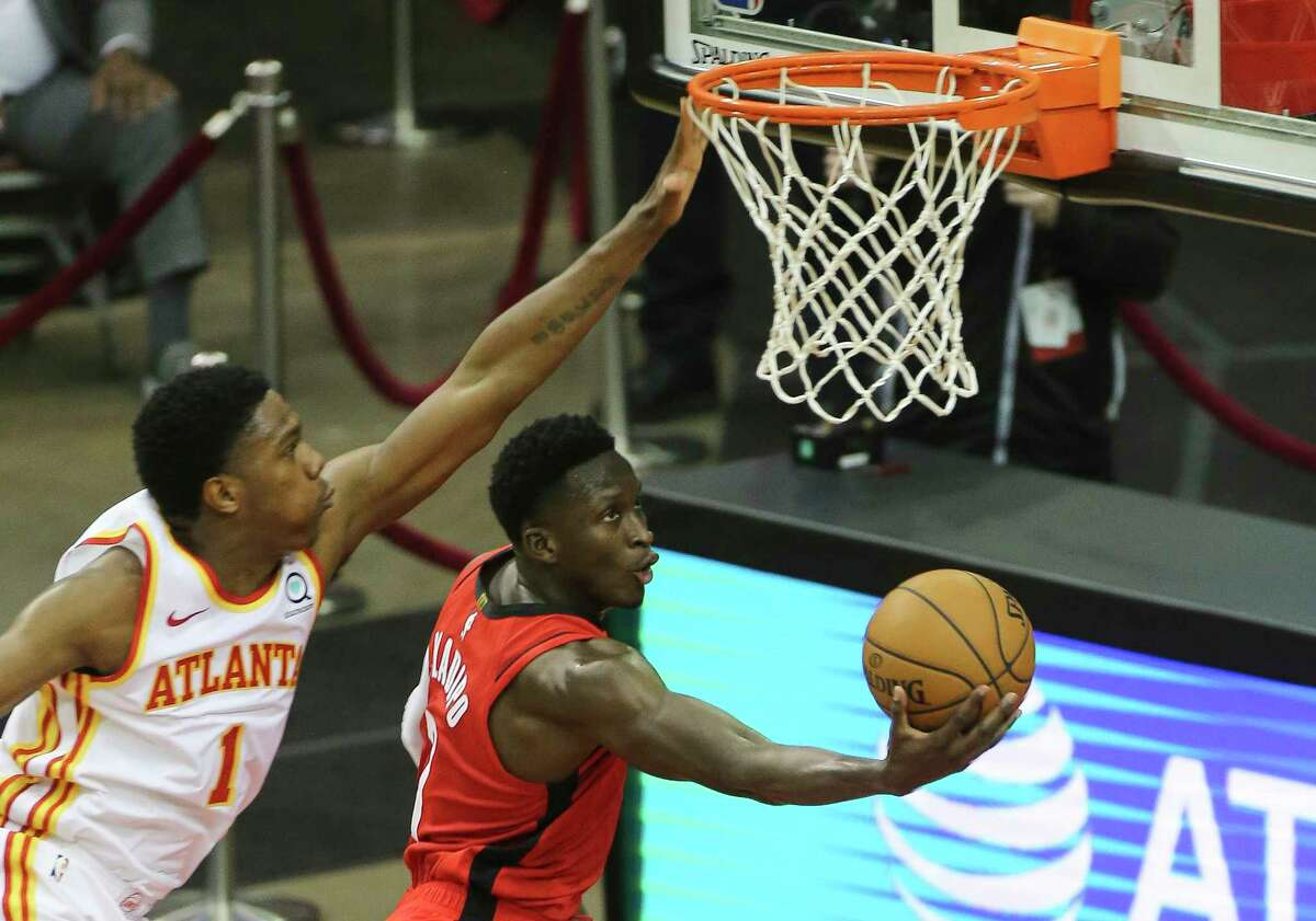 Houston Rockets guard Victor Oladipo (7) attempts to score a basket while Atlanta Hawks forward Nathan Knight (1) is trying to stop him during the second quarter of the NBA game Tuesday, March 16, 2021, at Toyota Center in Houston.