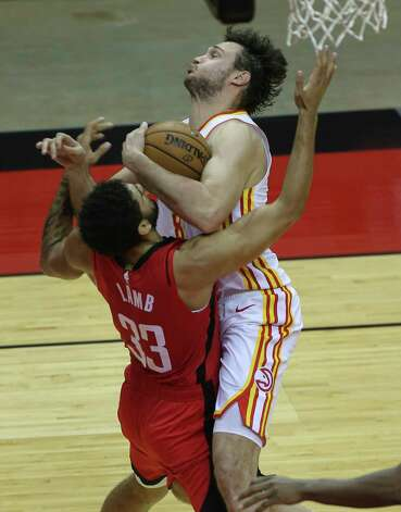 Houston Rockets forward Anthony Lamb (33) falls onto the floor after Atlanta Hawks forward Danilo Gallinari (8) ran into him after grabbing a rebound durign the fourth quarter of the NBA game Tuesday, March 16, 2021, at Toyota Center in Houston. Photo: Yi-Chin Lee, Staff Photographer / © 2021 Houston Chronicle