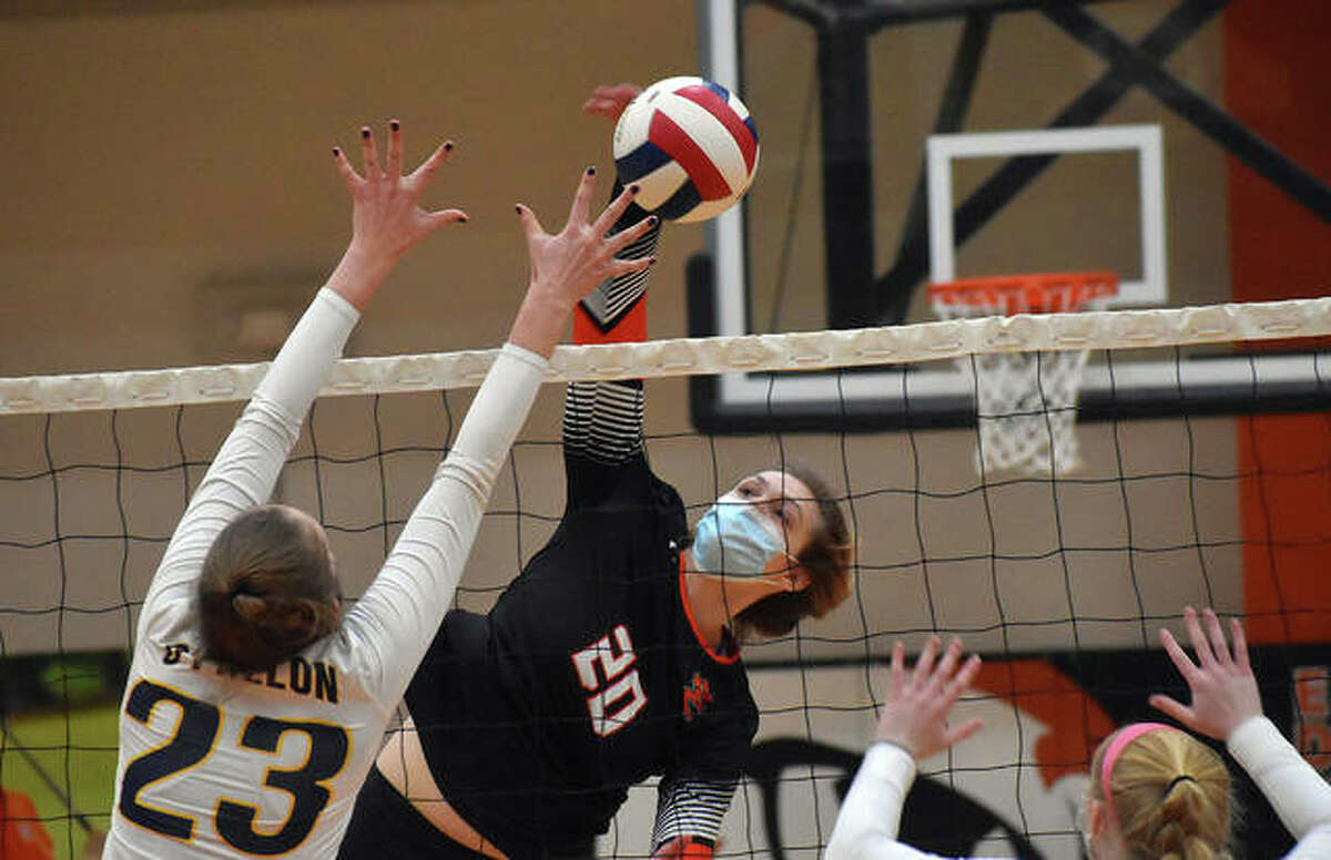 Edwardsville's Storm Suhre slams down one of her six kills in the second game against the O'Fallon Panthers on Tuesday inside Lucco-Jackson Gymnasium.