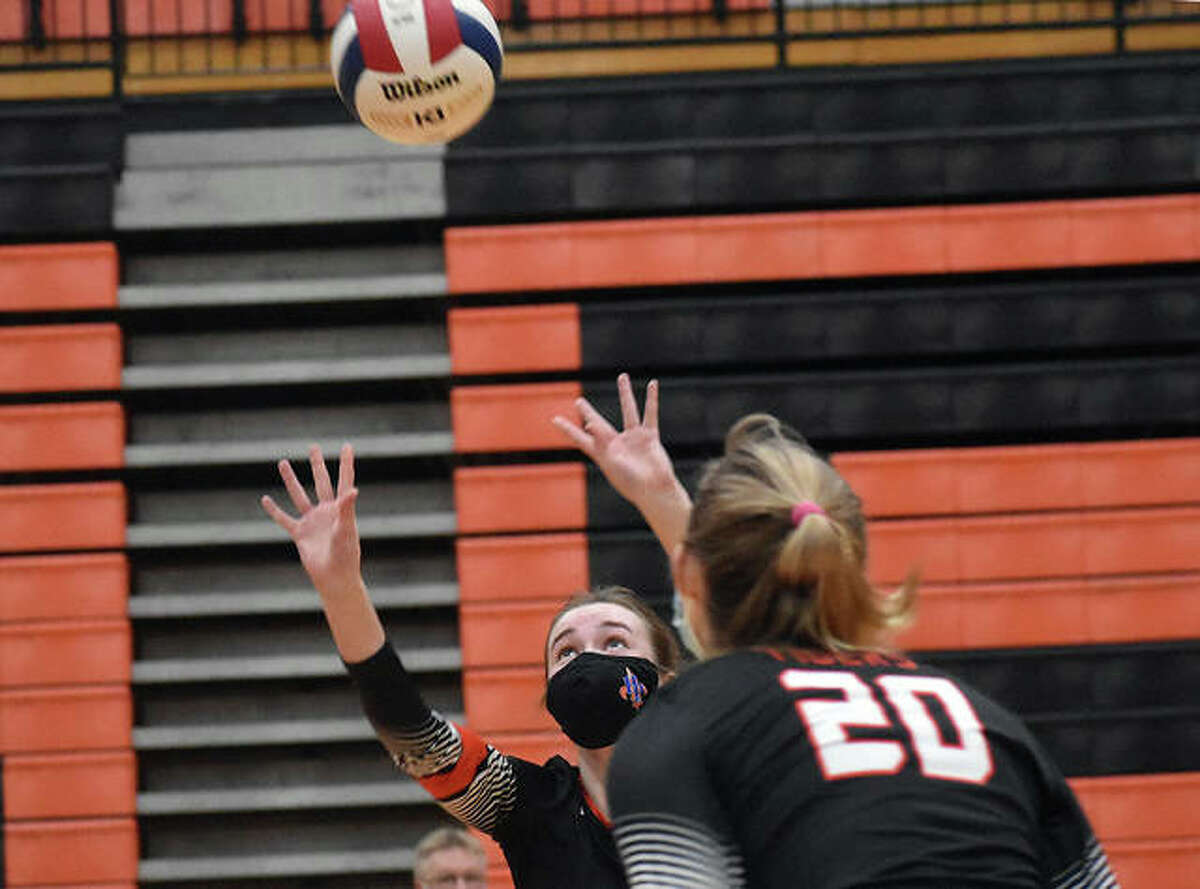 Edwardsville's Madison Vieth sets up a pass for Storm Suhre in the second game against the O'Fallon Panthers.
