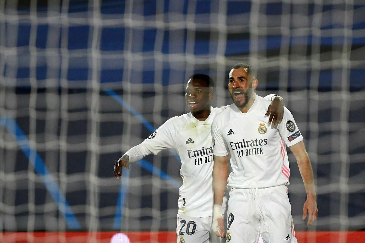 Real Madrid's French forward Karim Benzema (R) celebrates his goal with Real Madrid's Brazilian forward Vinicius Junior during the UEFA Champions League round of 16 second leg football match between Real Madrid CF and Atalanta at the Alfredo di Stefano stadium in Valdebebas, on the outskirts of Madrid on March 15, 2021. (Photo by PIERRE-PHILIPPE MARCOU / AFP) (Photo by PIERRE-PHILIPPE MARCOU/AFP via Getty Images)