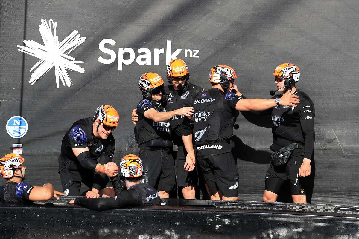 Crew members of Team New Zealand celebrate their victory against Luna Rossa in 36th America's Cup in Auckland.