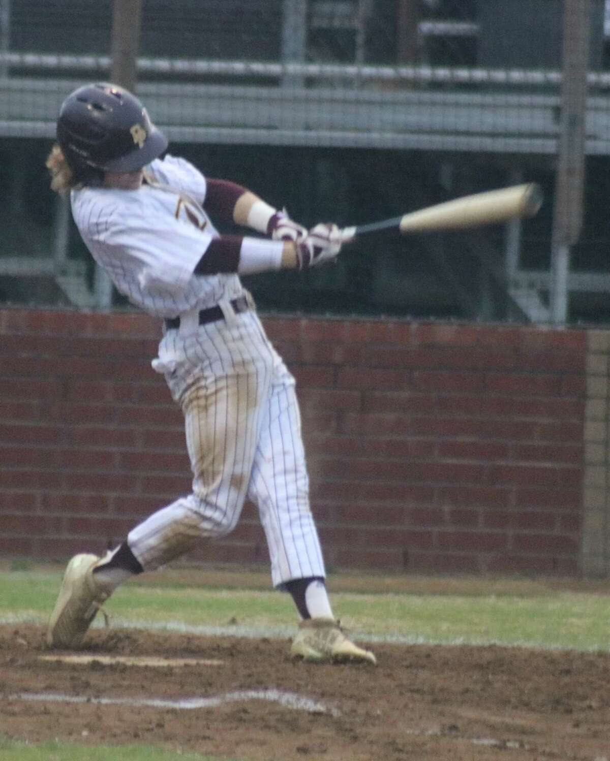 Wyatt Woodall connects for a two-RBI single in the first inning Tuesday night.