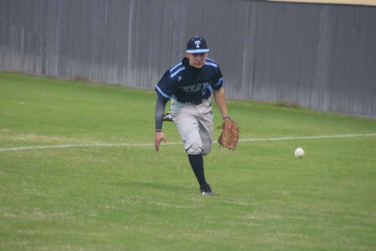 A foul ball just eludes Sam Rayburn's right fielder during Tuesday night's 22-6A game at Jim Kethan Field.