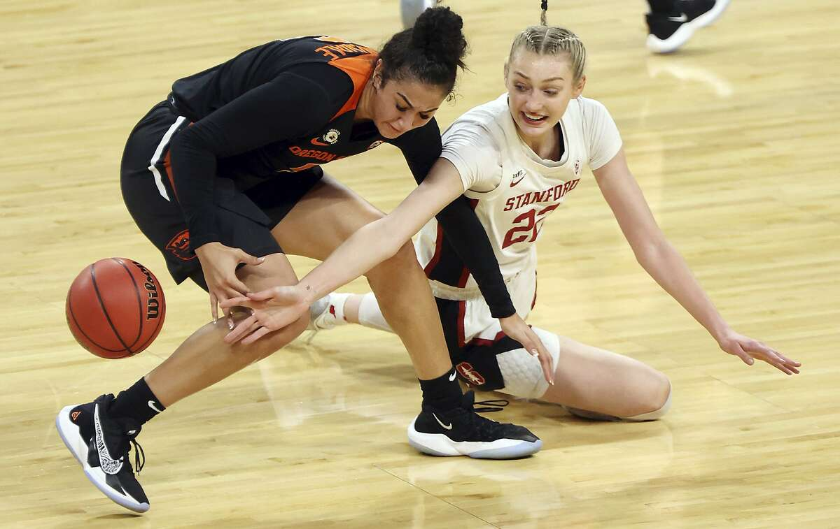 Oregon forward Taya Corosdale (5) and Stanford forward Cameron Brink (22) reach for the ball during the first half of an NCAA college basketball game in the semifinal round of the Pac-12 women's tournament Friday, March 5, 2021, in Las Vegas. (AP Photo/Isaac Brekken)