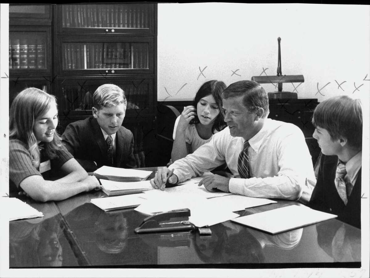 Students Stephanie Rower, Delmar; Steve Smith, Schenectady; Jean Dumas, Albany, and John Sawaya, Albany work with Assemblyman Fred Field on legislature. Field died at 88 on Friday, March 12, 2021. Undated (Roberta Smith/Times Union Archive)