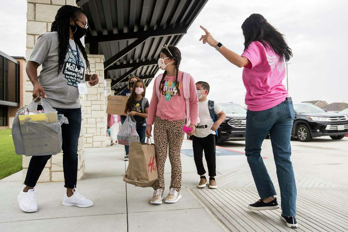 Katy Area Economic Development Council has put its support behind the Katy Independent School District 2021 bond propositions and funding for expansions at University of Houston at Katy. Here, Brittany Christmas, left, helps guide students from the car rider line for the first day of in-person classes at McElwain Elementary School on Tuesday, Sept. 8, 2020, in Katy.